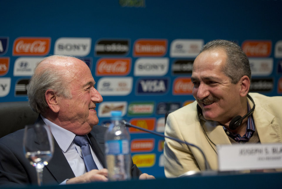 Photo - FIFA President Sepp Blatter, left, talks with Brazil's Sports Minister Aldo Rebelo during a press conference where they talked about the organization and infrastructure of the upcoming World Cup, in Sao Paulo, Brazil, Thursday, June 5, 2014. The World Cup soccer tournament starts on 12 June. (AP Photo/Andre Penner)