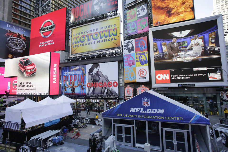 Photo - An information tent, lower right, is in place for Super Bowl Boulevard in New York's Times Square, Tuesday, Jan. 28, 2014. Thirteen blocks of midtown Manhattan have been converted into a temporary festival space leading up to the National Football League's championship game between the Seattle Seahawks and the Denver Broncos on  Sunday, Feb. 2, in East Rutherford, N.J. (AP Photo/Mark Lennihan)