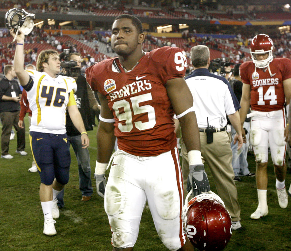 Photo - Alan Davis of OU walks off the field after the Fiesta Bowl college football game between the University of Oklahoma Sooners (OU) and the West Virginia University Mountaineers (WVU) at The University of Phoenix Stadium on Wednesday, Jan. 2, 2008, in Glendale, Ariz. 