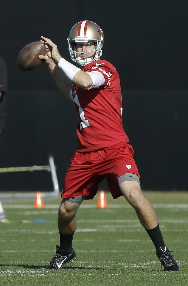 Photo - San Francisco 49ers quarterback Alex Smith (11) practices at an NFL football training facility in Santa Clara, Calif., Friday, Jan. 25, 2013. The 49ers are scheduled to play the Baltimore Ravens in the Super Bowl on Sunday, Feb. 3. (AP Photo/Jeff Chiu)