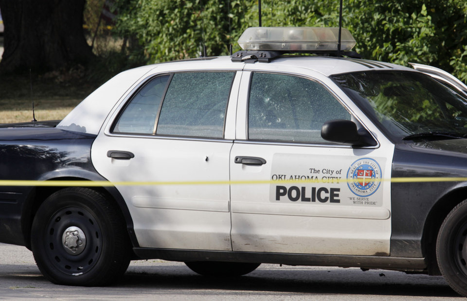 Photo -  An Oklahoma City police car riddled with bullet holes sitting on Miller Avenue just south of NW 39 Street Monday, August 30, 2010. A female Oklahoma City police officer was shot in the car. Photo by Paul B. Southerland, The Oklahoman