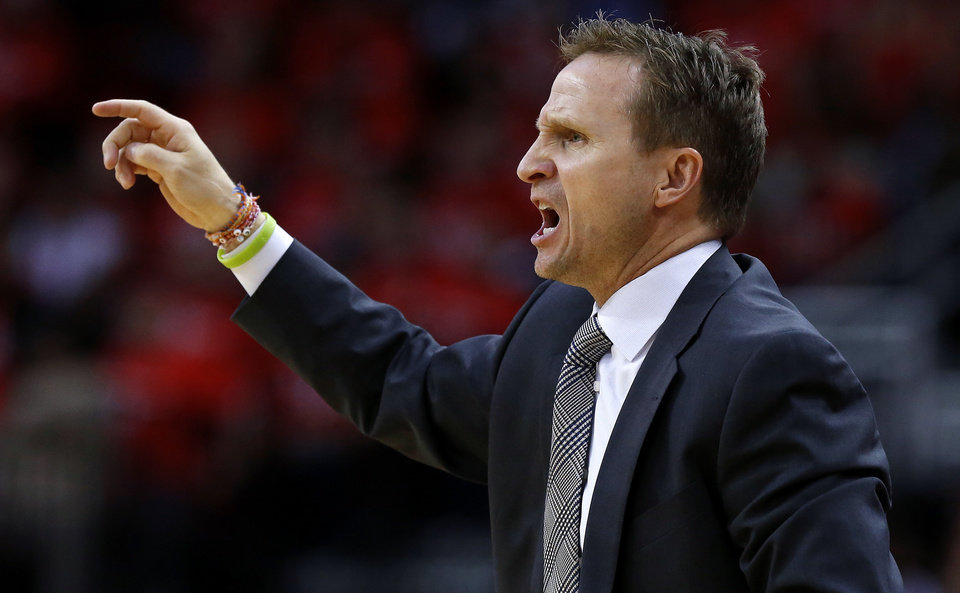 Oklahoma City coach Scott Brooks shouts during Game 6 in the first round of the NBA playoffs between the Oklahoma City Thunder and the Houston Rockets at the Toyota Center in Houston, Texas, Friday, May 3, 2013. Oklahoma City won 103-94. Photo by Bryan Terry, The Oklahoman
