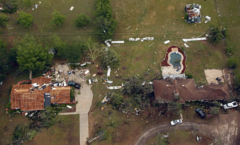 Photo - This aerial photo shows homes that were damaged by Wednesday's tornado in Cleburne, Texas on Thursday, May 16, 2013.  Ten tornadoes touched down in several small communities in Texas overnight, leaving at least six people dead, dozens injured and hundreds homeless. Emergency responders were still searching for missing people Thursday afternoon.  (AP Photo/The Dallas Morning News, G.J.McCarthy)  MANDATORY CREDIT; MAGS OUT; TV OUT; INTERNET USE BY AP MEMBERS ONLY; NO SALES