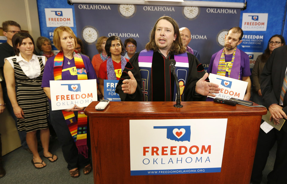 Photo -      The Rev. Allen Buck, pastor of Summit United Methodist Church, speaks in support of marriage equality at the state Capitol in Oklahoma City on Tuesday. Photo By Steve Gooch, The Oklahoman   Steve Gooch -