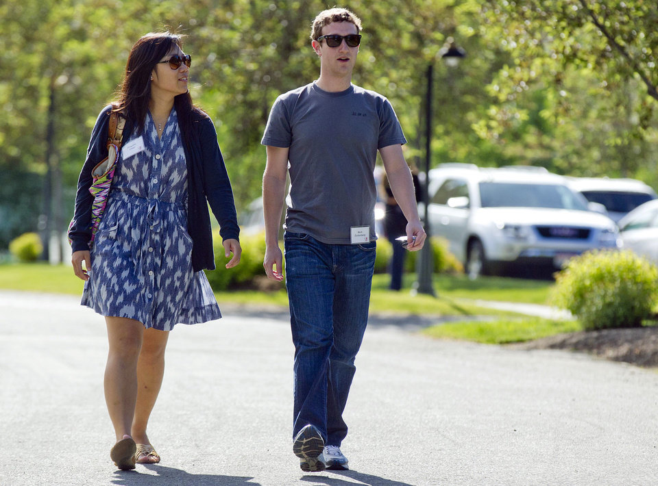 Photo - FILE- In this July 9, 2011, file photo, Mark Zuckerberg, president and CEO of Facebook, walks to morning sessions with his then girlfriend Priscilla Chan during the 2011 Allen and Co. Sun Valley Conference, in Sun Valley, Idaho.  Zuckerberg and his wife, Priscilla Chan, announced Thursday May 29, 2014 they are donating $120 million to the San Francisco Bay Area's public school system. Zuckerberg and Chan, a pediatrician, discussed the donation in an exclusive interview with the Associated Press. (AP Photo/Julie Jacobson)