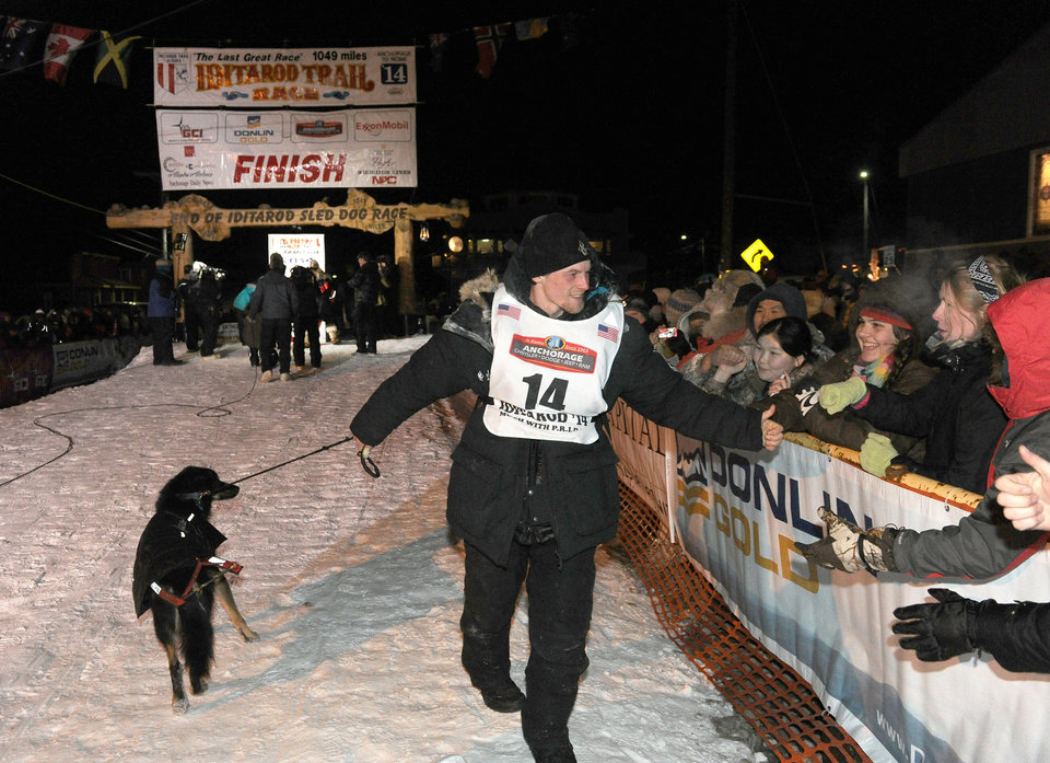 Photo - Dallas Seavey greets fans after winning the 2014 Iditarod Trail Sled Dog Race in Nome, Alaska, Tuesday, March 11, 2014.  (AP Photo/The Anchorage Daily News, Bob Hallinen)  LOCAL TV OUT (KTUU-TV, KTVA-TV) LOCAL PRINT OUT (THE ANCHORAGE PRESS, THE ALASKA DISPATCH)