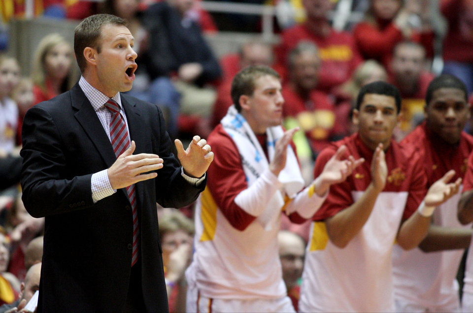 Photo - Iowa State coach Fred Hoiberg yells instructions to his team during the first half of an NCAA college basketball game against TCU at Hilton Coliseum in Ames, Iowa, Saturday, Feb. 8, 2014. (AP Photo/Justin Hayworth)