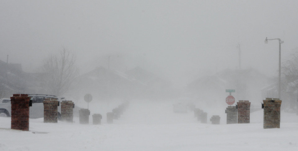 Photo - A street in a northwest Oklahoma City neighborhood through the blowing snow on Feb. 1, 2011.  Photo by Bryan Terry, The Oklahoman