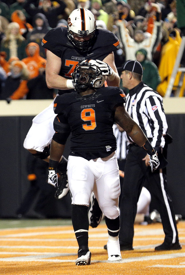 Oklahoma State\'s Kye Staley (9) and Parker Graham (71) celebrate a Staley touchdown in the third quarter during a college football game between the Oklahoma State University Cowboys (OSU) and the Baylor University Bears (BU) at Boone Pickens Stadium in Stillwater, Okla., Saturday, Nov. 23, 2013. Photo by Sarah Phipps, The Oklahoman