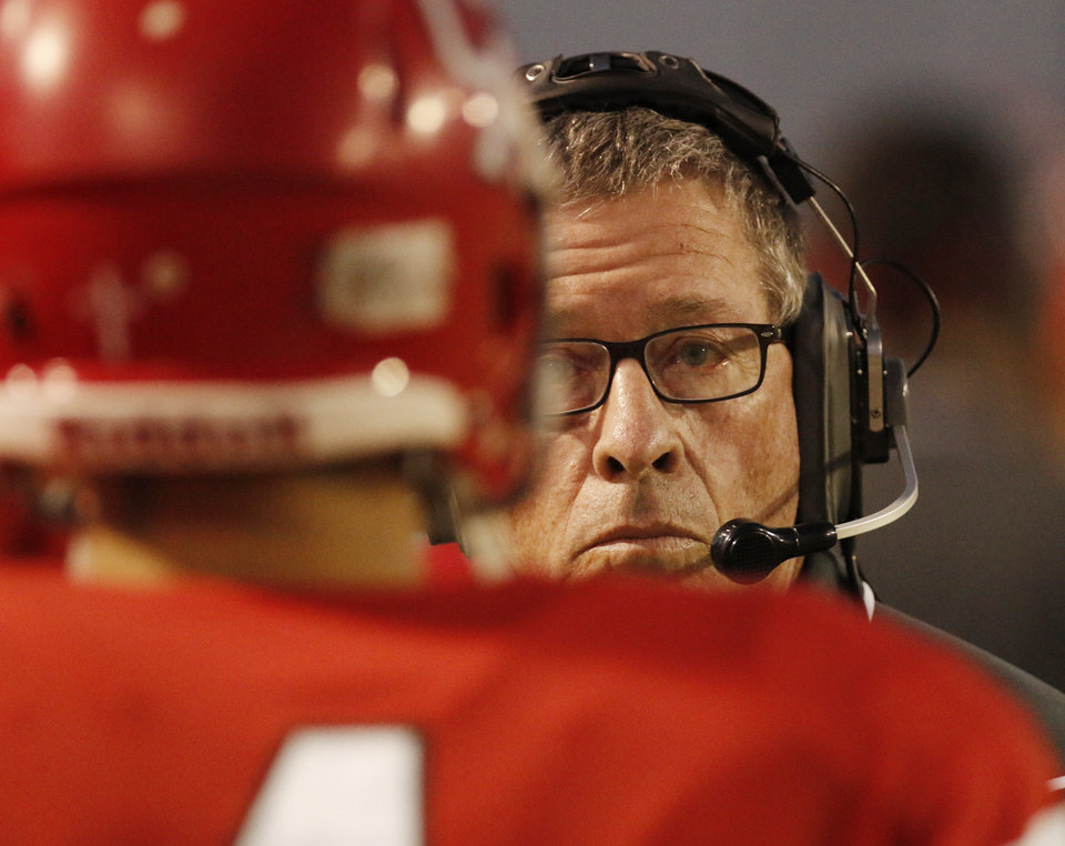 Photo - Carl Albert head coach Gary Rose talks with players during the high school football game between Guthrie at Carl Albert in Midwest City, Friday, October 11, 2013.  Photo by Doug Hoke, The Oklahoman