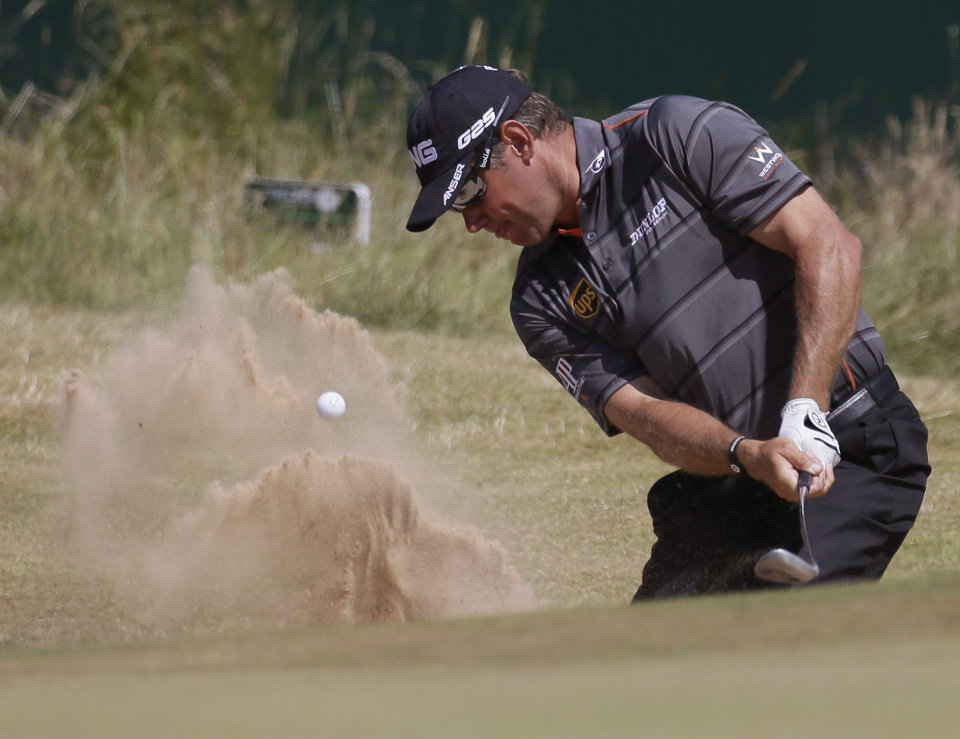 Lee Westwood of England plays out of a bunker on the 18th hole during the second round of the British Open Golf Championship at Muirfield, Scotland, Friday July 19, 2013. (AP Photo/Jon Super)