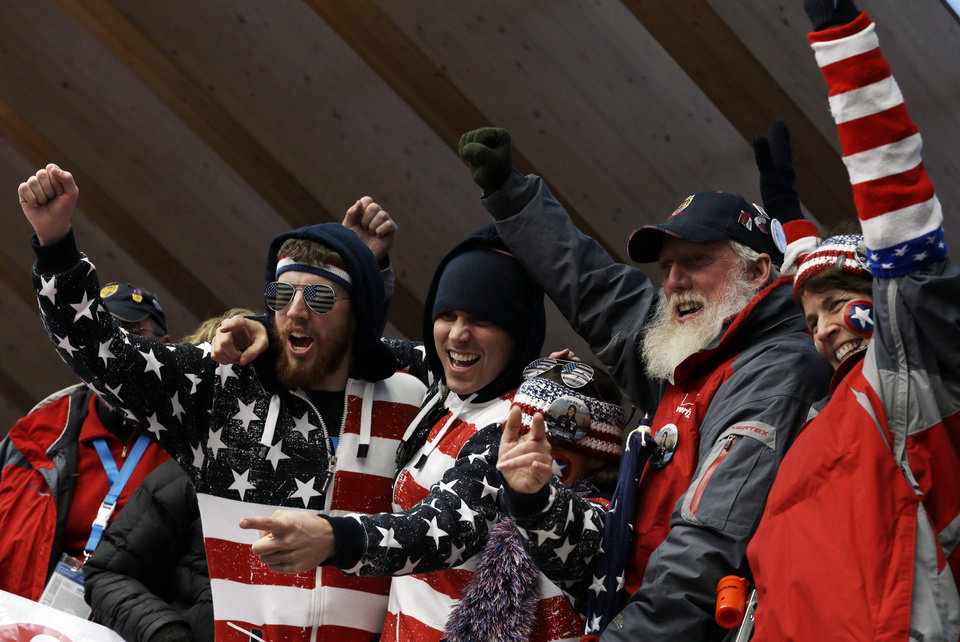 Photo - Friends and family of Erin Hamlin of the United States, wait for the start of the women's singles luge competition at the 2014 Winter Olympics, Tuesday, Feb. 11, 2014, in Krasnaya Polyana, Russia. (AP Photo/Natacha Pisarenko)