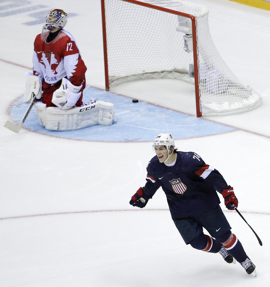 Photo - USA forward T.J. Oshie reacts after scoring the winning goal against Russia goaltender Sergei Bobrovski in a shootout during overtime of a men's ice hockey game at the 2014 Winter Olympics, Saturday, Feb. 15, 2014, in Sochi, Russia. (AP Photo/David J. Phillip )