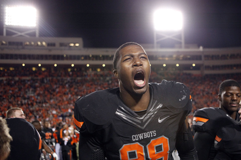 Photo - Oklahoma State's Davidell Collins (98)celebrates the Cowboys win over Kansas State during a college football game between the Oklahoma State University Cowboys (OSU) and the Kansas State University Wildcats (KSU) at Boone Pickens Stadium in Stillwater, Okla., Saturday, Nov. 5, 2011.  Photo by Sarah Phipps, The Oklahoman