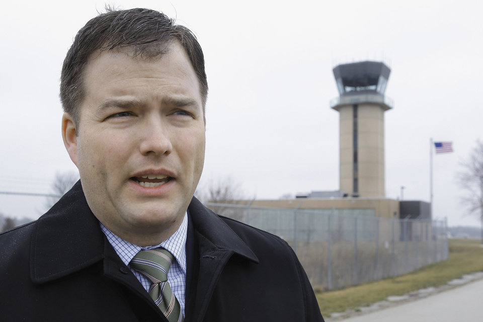 In this March 11, 2013 photo, Mark Hanna, director of the Abraham Lincoln Capital Airport in Springfield, Ill., talks about the possible closing of the air traffic control tower behind him and nearly 240 more around the country under federal budget cuts. Airport directors and pilots are concerned that eliminating a second pair of eyes on the ground will increase risk throughout the American air-transport system, the world's safest. (AP Photo/Seth Perlman)