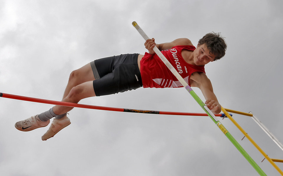 Photo - Duncan's Jarad Reyes competes in the pole vault during the class 5A and 6A track state championships at Yukon High School on on Friday, May 10, 2013, in Yukon, Okla.Photo by Chris Landsberger, The Oklahoman