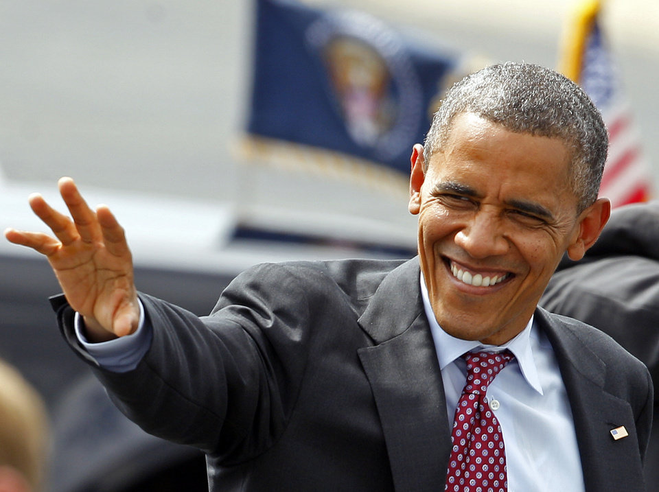 Photo -   President Barack Obama waves to supporters as he arrives at the Charlotte/Douglas International Airport for the Democratic National Convention in Charlotte, N.C., Wednesday, Sept. 5, 2012. (AP Photo/Chuck Burton)