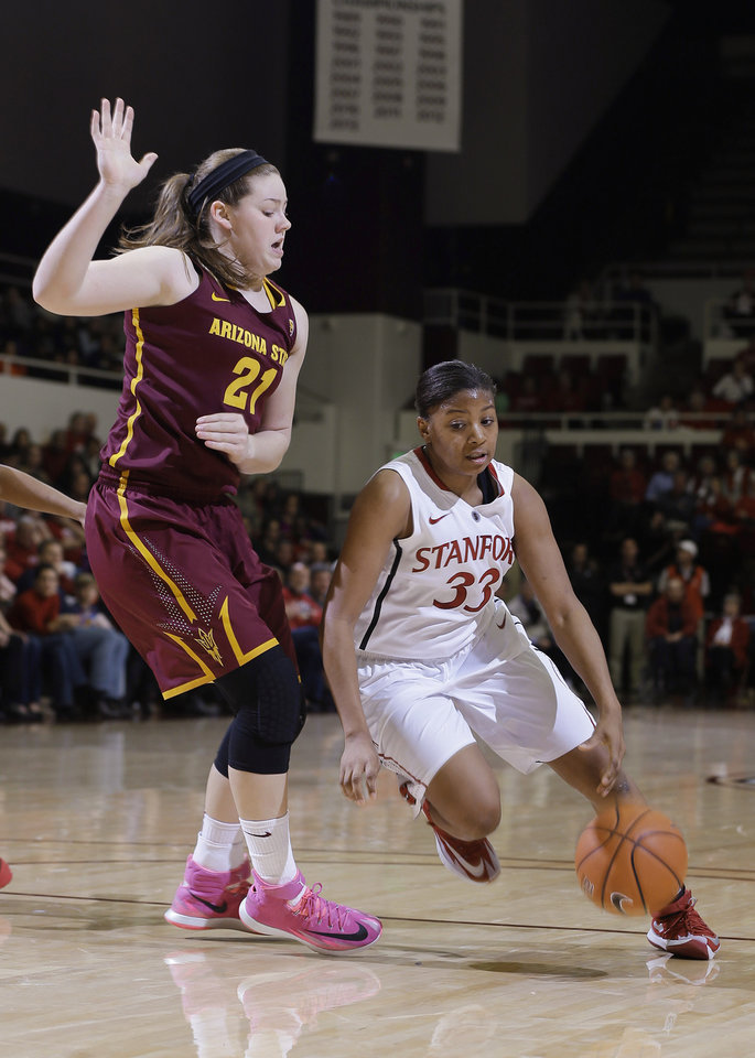 Photo - Stanford guard Amber Orrange (33) dribbles around Arizona State forward Sophie Brunner during the first half of an NCAA college basketball game Friday, Feb. 14, 2014, in Stanford, Calif. (AP Photo/Marcio Jose Sanchez)
