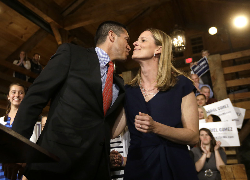 Photo - Republican candidate for the U.S. Senate Gabriel Gomez, left, kisses his wife, Sarah, as he takes to the stage before addressing an audience with a victory speech at a watch party, in Cohasset, Mass., Tuesday, April 30, 2013. Gomez won his primary bid for the Republican nomination to contest a U.S. Senate seat, defeating Republican hopefuls Michael Sullivan and Dan Winslow. (AP Photo/Steven Senne)