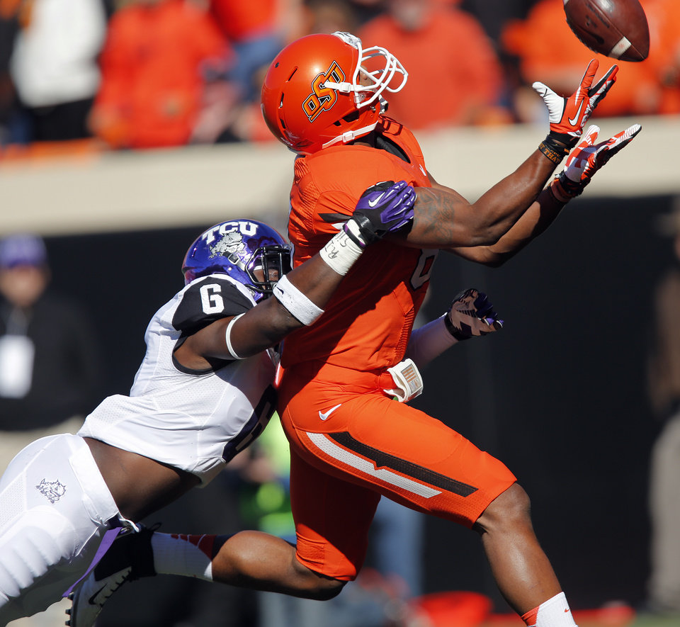 TCU\'s Elisha Olabode (6) breaks up a pass for Oklahoma State\'s Tracy Moore (87) during a college football game between the Oklahoma State University Cowboys (OSU) and the Texas Christian University Horned Frogs (TCU) at Boone Pickens Stadium in Stillwater, Okla., Saturday, Oct. 19, 2013. Photo by Chris Landsberger, The Oklahoman