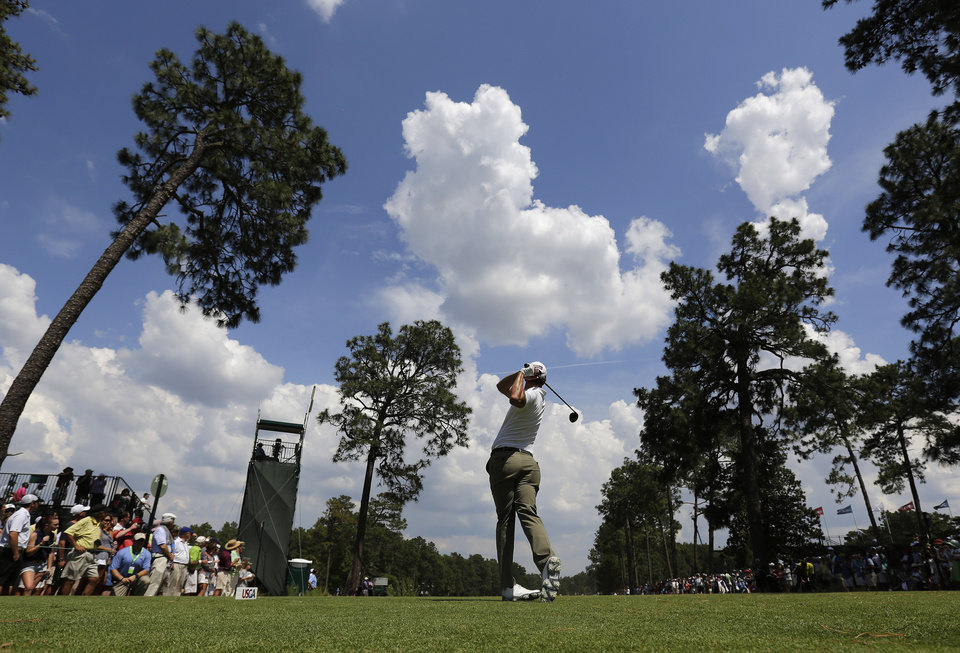 Photo - Adam Scott, of Australia, hits his tee shot on the 18th hole during a practice round for the U.S. Open golf tournament in Pinehurst, N.C., Wednesday, June 11, 2014. The tournament starts Thursday. (AP Photo/Eric Gay)