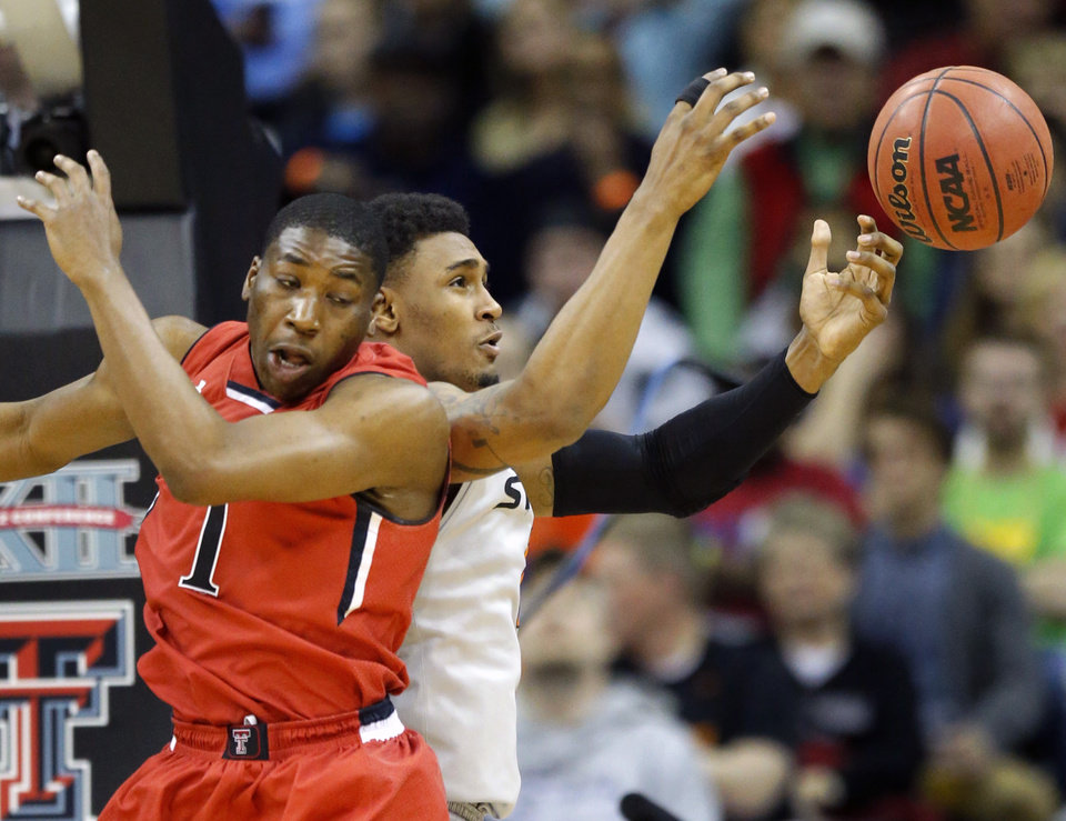 Photo - Oklahoma State forward Le'Bryan Nash,right, rebounds against Texas Tech guard Randy Onwuasor (1) during the first half of an NCAA college basketball game in the Big 12 men's tournament in Kansas City, Mo., Wednesday, March 12, 2014. (AP Photo/Orlin Wagner)