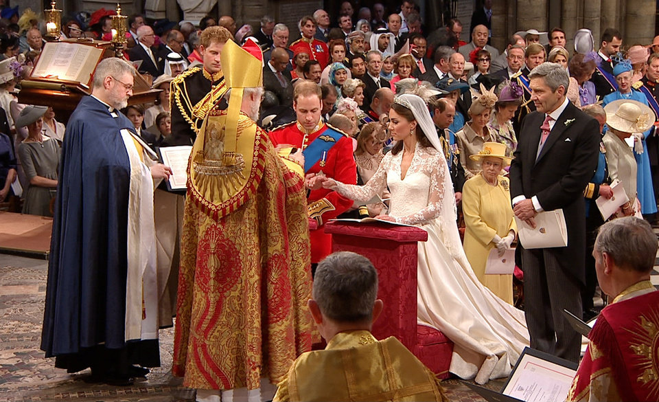 Photo - In this image taken from video, Britain's Prince William, left, and Kate Middleton, right, kneel at the altar at Westminster Abbey for the Royal Wedding in London on Friday, April, 29, 2011. (AP Photo/APTN) EDITORIAL USE ONLY NO ARCHIVE PHOTO TO BE USED SOLELY TO ILLUSTRATE NEWS REPORTING OR COMMENTARY ON THE FACTS OR EVENTS DEPICTED IN THIS IMAGE ORG XMIT: RWVM185