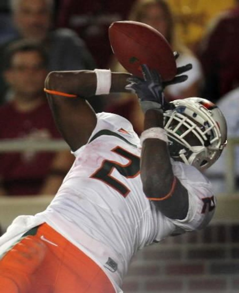Miami running back  Graig  Cooper makes a fourth-quarter touchdown catch to tie the game against Florida State during an NCAA college football game Monday, Sept. 7, 2009, in Tallahassee, Fla. Miami won 38-34. (AP Photo/Phil Coale)