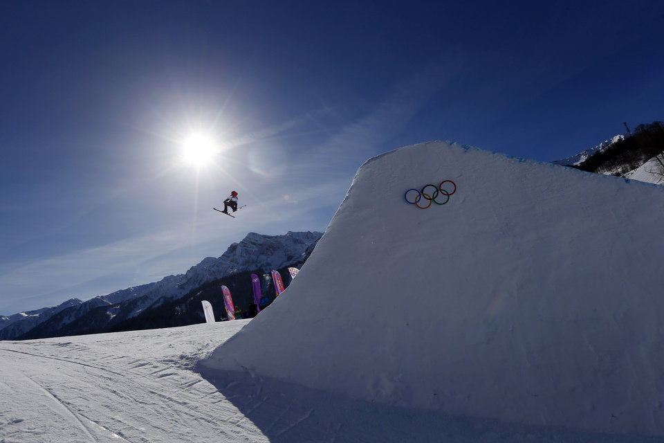 Photo - Britain's James Woods takes a jump during ski slopestyle training at the Rosa Khutor Extreme Park ahead of the 2014 Winter Olympics, Friday, Feb. 7, 2014, in Krasnaya Polyana, Russia. (AP Photo/Sergei Grits)