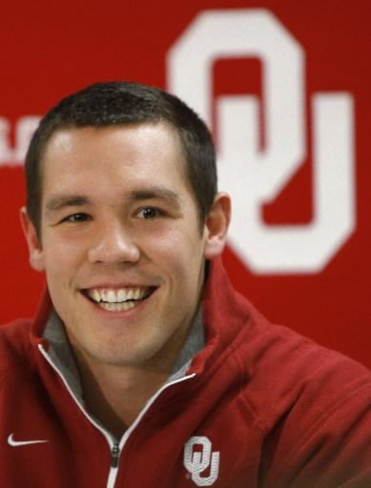 Photo - Former Oklahoma quarterback Sam Bradford talks during a press conference before the NCAA college basketball game between the University of Oklahoma Sooners (OU) and Texas Longhorns at Lloyd Noble Center in Norman, Okla., Wednesday, Feb. 9, 2011. Photo by Bryan Terry, The Oklahoman