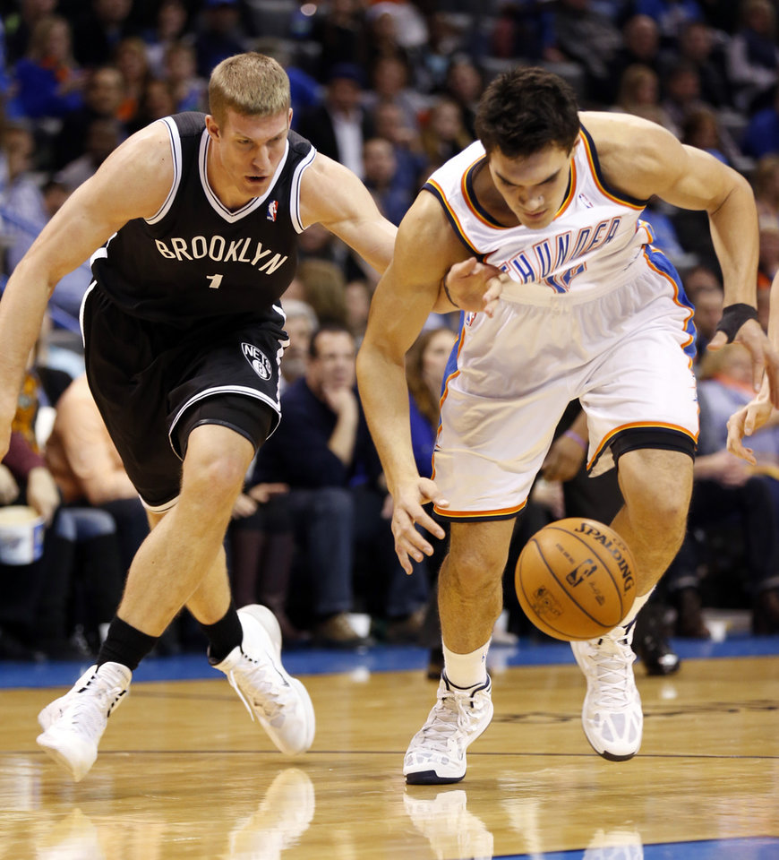 Photo - Thunder's Steven Adams (12) and Brooklyn's Mason Plumlee (1) fight for the ball in an NBA basketball game between the Oklahoma City Thunder and the Brooklyn Nets at the Chesapeake Energy Arena in Oklahoma City, on Thursday, Jan. 2, 2014.. Photo by Steve Sisney, The Oklahoman