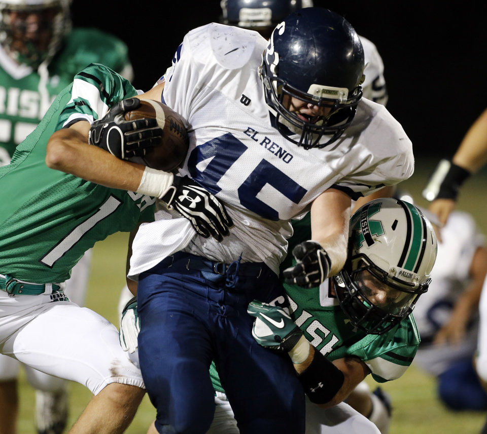 Photo - El Reno running back Murdoch Marcum (45) carries as the Indians play the Bishop McGuinness Fighting Irish in high school football on Friday, Sept. 21, 2012 in Oklahoma City, Okla.  Photo by Steve Sisney, The Oklahoman