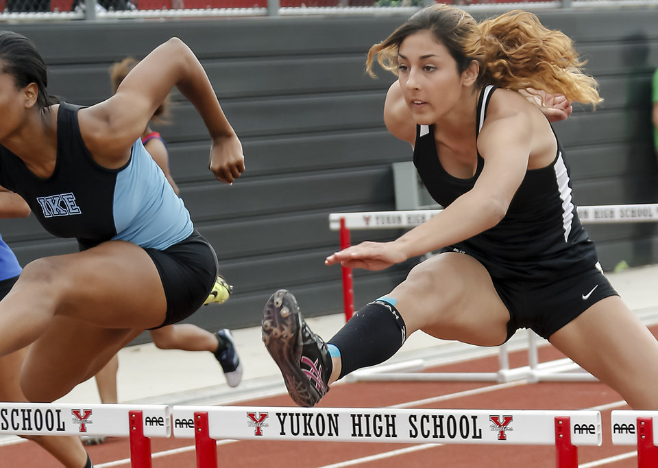 Putnam City's Schuyler Wood races in the 6A girls 100m hurdles during the class 5A and 6A track state championships at Yukon High School on on Friday, May 10, 2013, in Yukon, Okla.Photo by Chris Landsberger, The Oklahoman