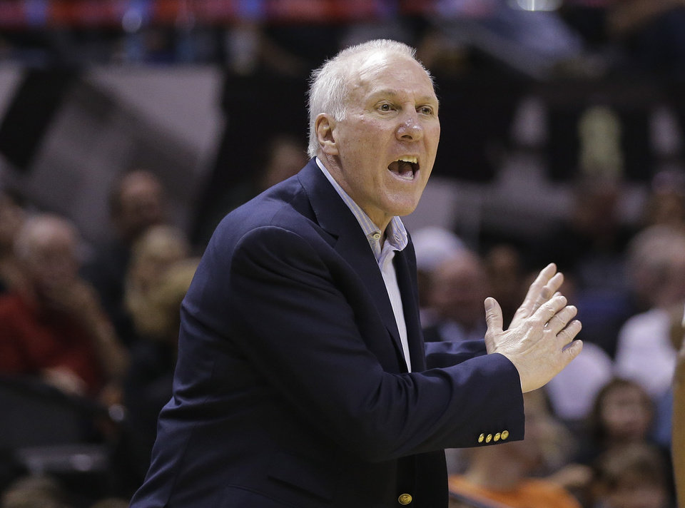 Photo - San Antonio Spurs head coach Gregg Popovich argues a call during the second half of an NBA basketball game against the Memphis Grizzlies, Wednesday, Oct. 30, 2013, in San Antonio. (AP Photo/Eric Gay)