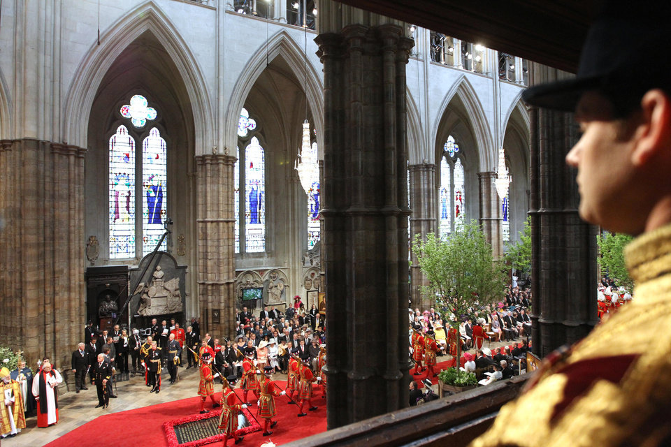 Photo - Guests attend the wedding service of Britain's Prince William and Kate, the Duchess of Cambridge, at Westminster Abbey, London, Friday April 29, 2011. (AP Photo/Adrian Dennis, Pool)