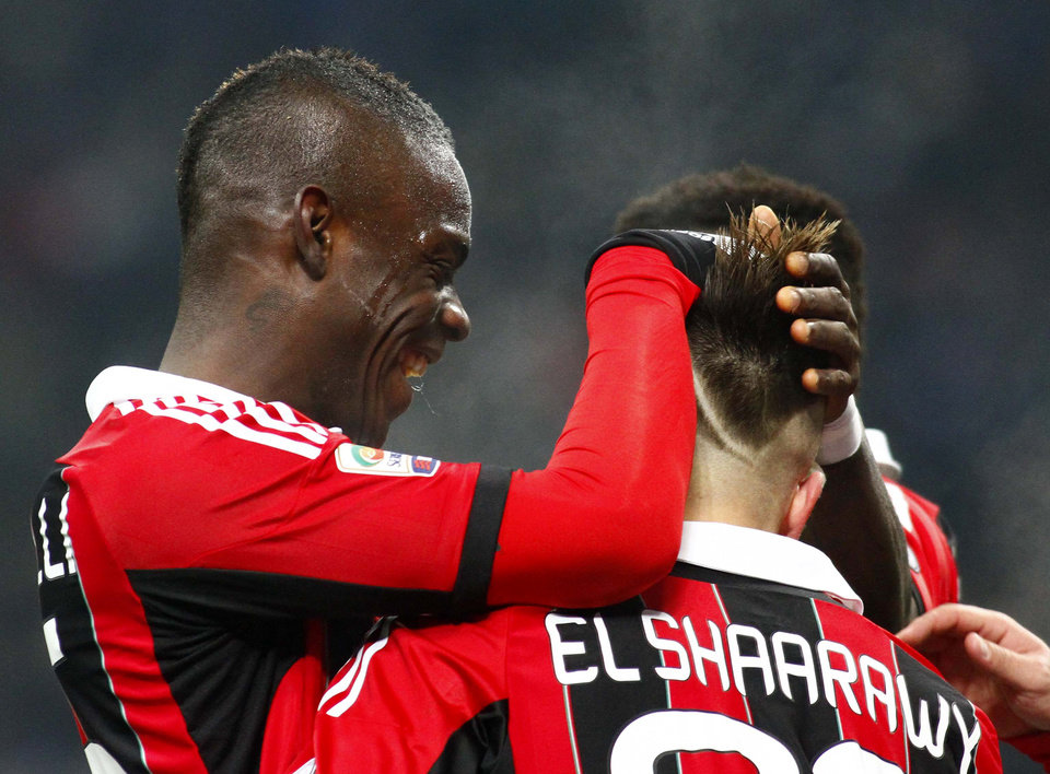 Photo - AC Milan forward Stephan El Shaarawy, right, is joined by teammate Mario Balotelli as he celebrates after scoring during the Serie A soccer match between Inter Milan and AC Milan at the San Siro stadium in Milan, Italy, Sunday, Feb. 24, 2013. (AP Photo/Simone Spada, Lapresse)