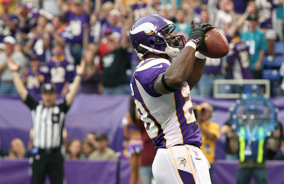 Photo - Minnesota Vikings running back Adrian Peterson reacts after scoring a touchdown during the first half of an NFL football game against the Jacksonville Jaguars, Sunday, Sept. 9, 2012, in Minneapolis. (AP Photo/Genevieve Ross)  Genevieve Ross