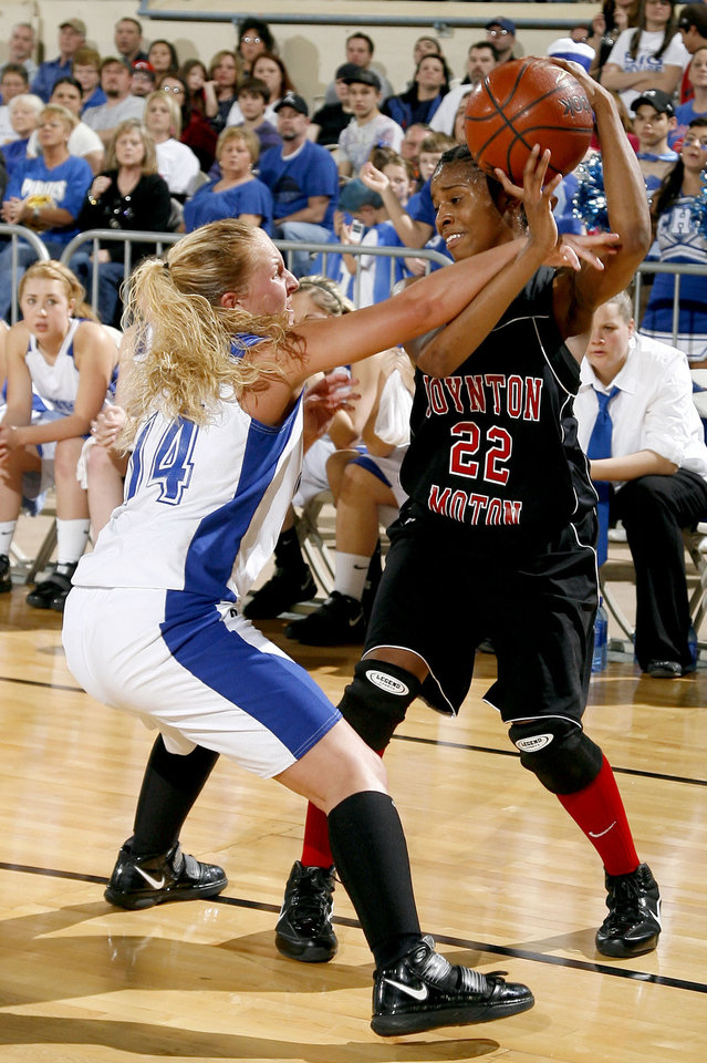 Photo - Boynton-Moton's Breanna Hutinson (22) looks to pass as Cyril's Shelbie Laughlin defends during the finals of the Class B girls basketball state tournament  between Cyril and Boynton-Moton at the State Fair Arena, Saturday, March 6, 2010, in Oklahoma City. Photo by Sarah Phipps, The Oklahoman