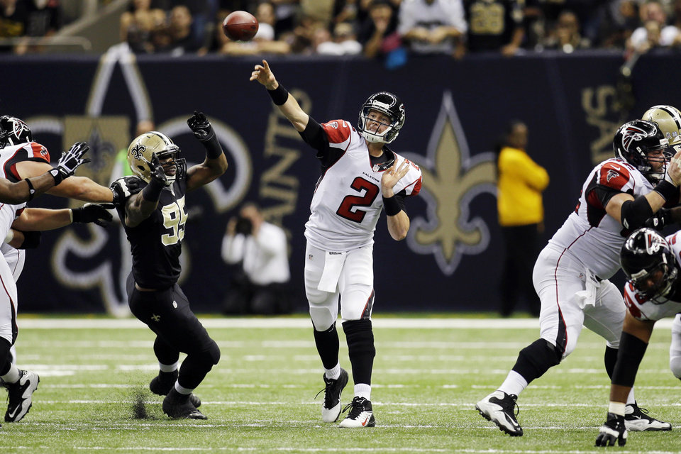 Photo -   Atlanta Falcons quarterback Matt Ryan (2) passes from the pocket in the first half of an NFL football game against the Atlanta Falcons at Mercedes-Benz Superdome in New Orleans, Sunday, Nov. 11, 2012. (AP Photo/Bill Haber)