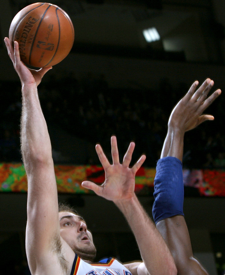 Photo - Oklahoma City's Nenad Krstic is pressured by Indiana's defense as he takes a shot during the NBA basketball game between the Indiana Pacers and the Oklahoma City Thunder at the Ford Center in Oklahoma City, Sunday, April 5, 2009. The Thunder lost 117 to 99. Photo by John Clanton, The Oklahoman