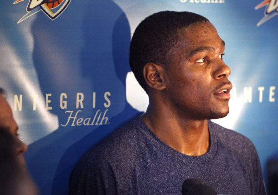 Photo - Kevin Durant speaks to reporters during the Thunder's after practice media event at the Thunder practice facility in Oklahoma City, OK, Friday, May 20, 2011. By Paul Hellstern, The Oklahoman ORG XMIT: KOD  PAUL HELLSTERN