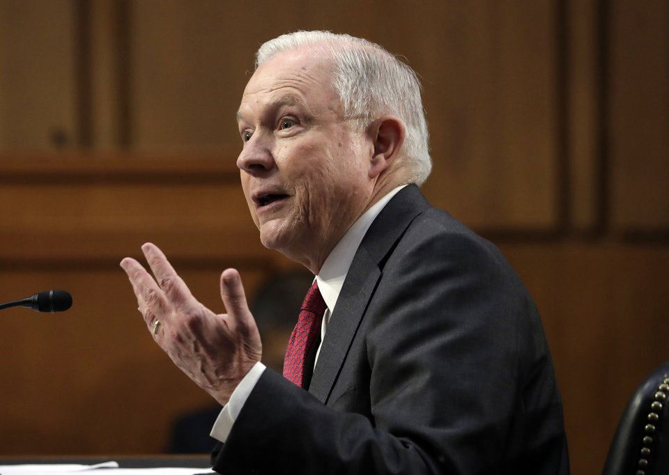 Photo - Attorney General Jeff Sessions testifies on Tuesday, June 13, 2017, on Capitol Hill in Washington, before the Senate Intelligence Committee hearing about his role in the firing of James Comey, his Russian contacts during the campaign and his decision to recuse from an investigation into possible ties between Moscow and associates of President Donald Trump.  (AP Photo/J. Scott Applewhite)