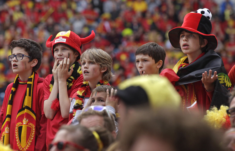Photo - Young fans of the Belgian national soccer team react after Algeria scored with a penalty, as they watch the match broadcast live on a giant video screen at the Ghelamco soccer stadium in Ghent, western Belgium, Tuesday, June 17, 2014. Belgium plays against Algeria, South Korea and Russia in Group H of the World Cup 2014 in Brazil. (AP Photo/Yves Logghe)