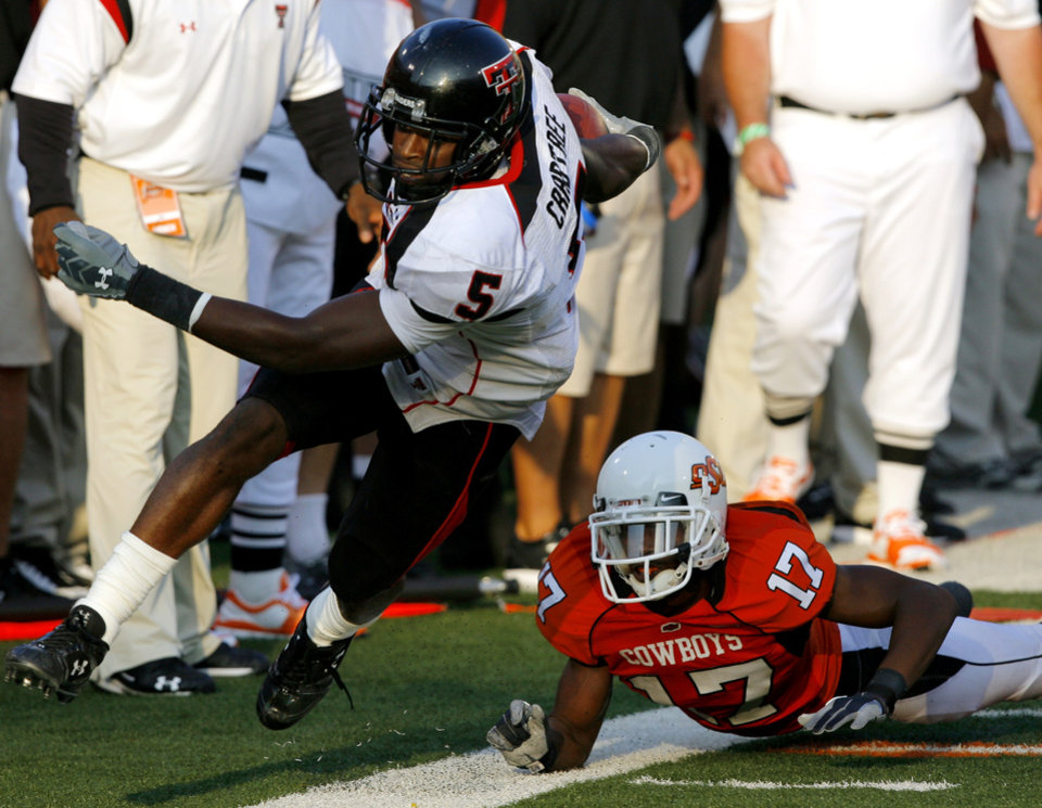 Texas Tech\'s Michael Crabtree runs past OSU\'s Jacob Lacey (17) during the second half of the college football game between the Oklahoma State University Cowboys (OSU) and the Texas Tech University Red Raiders (TTU) at Boone Pickens Stadium on Saturday, Sept. 22, 2007, in Stillwater, Okla. By MATT STRASEN, The Oklahoman