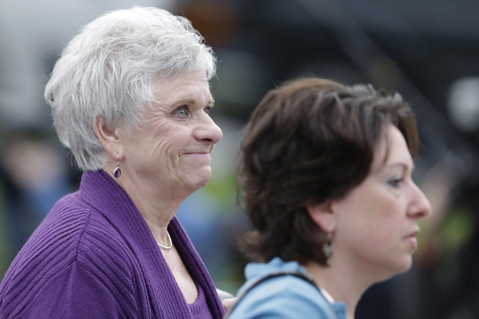 Dottie Sandusky, left, the wife of former Penn State University assistant football coach Jerry Sandusky, arrives at the Centre County Courthouse for her husband's sentencing hearing Tuesday, Oct. 9, 2012, in Bellefonte, Pa. Sandusky was convicted of sexually abusing 10 boys in a scandal that rocked the university and brought down Hall of Fame coach Joe Paterno. (AP Photo/Matt Rourke)