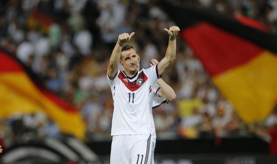 Photo - Germany's Miroslav Klose celebrates after a soccer friendly match between Germany and Armenia in the Coface Arena in Mainz, Germany, Friday, June 6, 2014.  Germany won 6-1. (AP Photo/Michael Probst)
