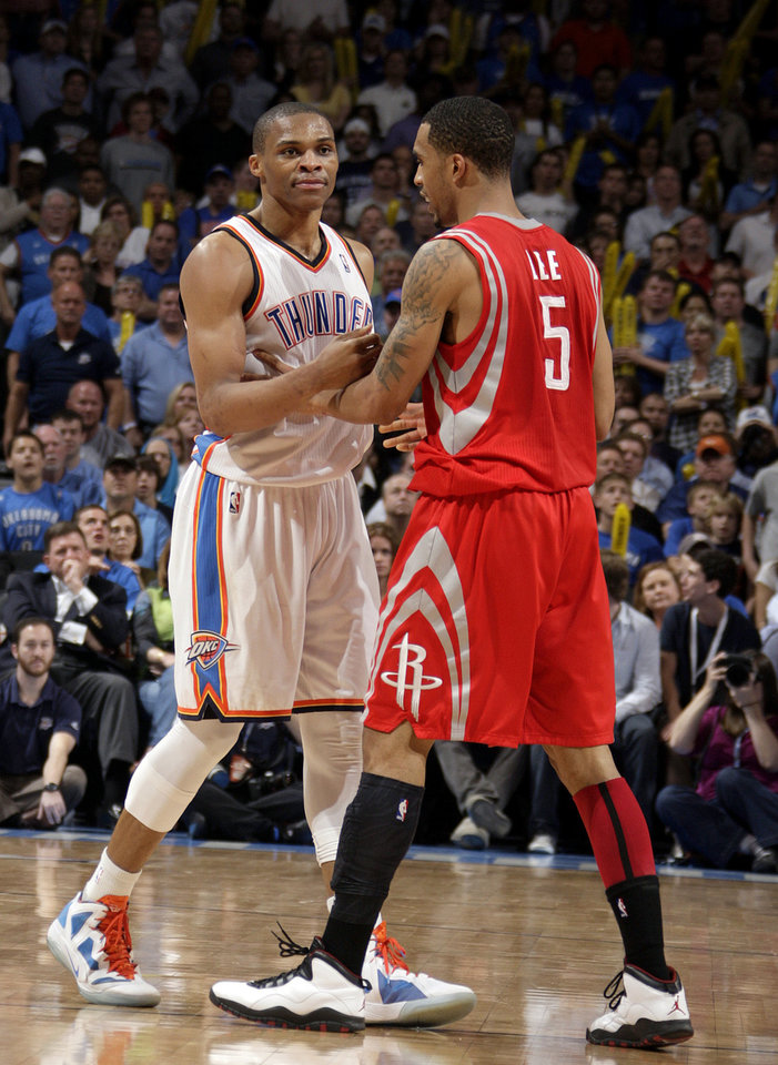 Photo - Oklahoma City's Russell Westbrook (0) is held back by Houston's Courtney Lee (5) after he is called for a technical during the NBA basketball game between the Oklahoma City Thunder and the Houston Rockets at the Chesapeake Energy Arena, Tuesday, March 13, 2012. Photo by Sarah Phipps, The Oklahoman.