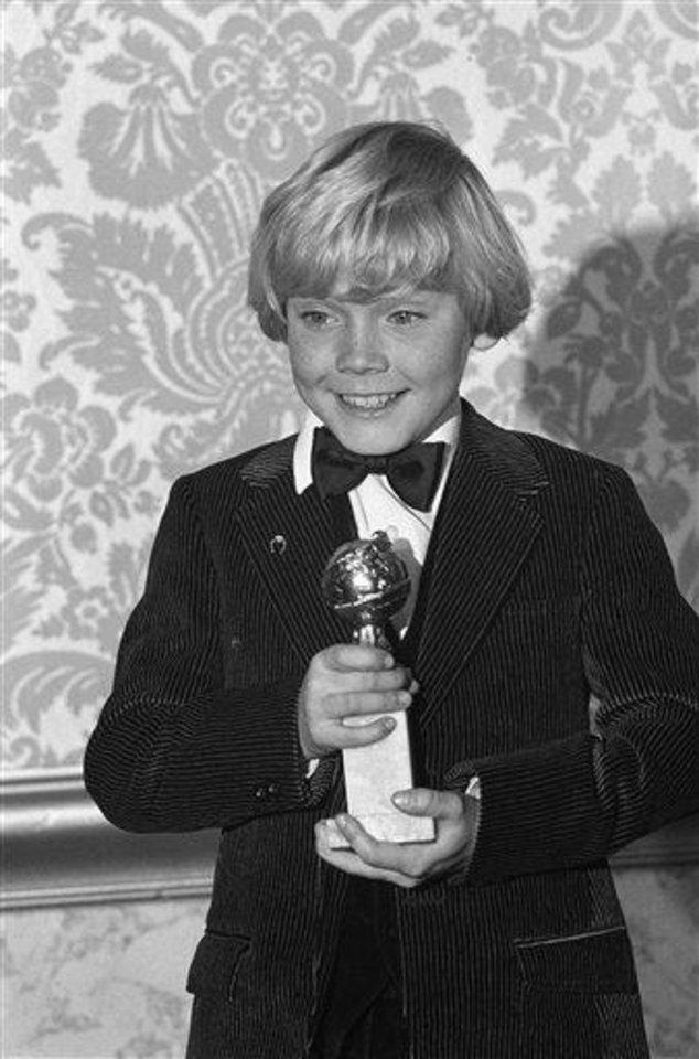"Child actor Ricky Schroder clutches his award presented him for New Male Star of the Year in a Motion Picture during ceremonies at the Hollywood Foreign Press Associations 1980 Golden Awards show Saturday night, Jan. 27, 1980 in Los Angeles. Schroder won for his part in the movie in the ""The Champ. "" (AP Photo/George Brich)"