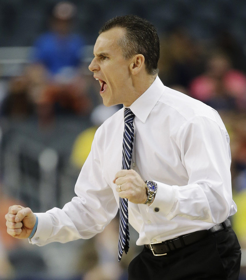 Photo - FILE - In this March 31, 2013 file photo, Florida head coach Billy Donovan reacts during a basketball game against Michigan at the NCAA college basketball tournament in Arlington, Texas. Donovan's roster is loaded with transfers, including the recent additions of South Florida center John Egbunu and Michigan forward Jon Horford. Donovan now has seven players who started elsewhere, a strategy that is fast becoming his trademark.  (AP Photo/David J. Phillip, File)