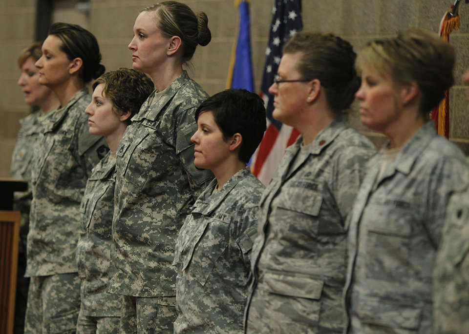 Kristen Auge, Deputy Director of Public Affairs, introduces soldiers from left, Army Sgt. 1st Class Katie Reed, Army Sgt. Cassie Mecuk, Army Staff Sgt. Andrea Drost, Army Sgt. Katie Warden, Air Force Maj. Ann Todd, and Air Force Master Sgt. Holly Caroon at the Inver Grove Heights, Minn., Training and Community Center following Secretary of Defense Leon E. Panetta\'s and Chairman of the Joint Chiefs of Staff General Martin E. Dempsey\'s announcement regarding women in combat. The Minnesota National Guard says it will integrate female soldiers into previously all-male combat infantry units. (AP Photo/The Star Tribune, Elizabeth Flores) MANDATORY CREDIT; ST. PAUL PIONEER PRESS OUT; MAGS OUT; TWIN CITIES TV OUT